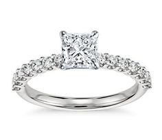 Exquisite in design, this diamond engagement ring features a delicate row of U-prong set diamonds to beautifully frame your center diamond. Setting includes 1/3 carat total diamond weight.  #BlueNile