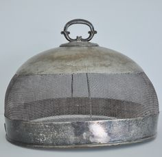 Beautiful vintage silver food cover from Ojoli They have simpler ones that you use outside to keep the flies off the food in the summer. This one is really fine and hard to find. There are newer more inexpensive ones.