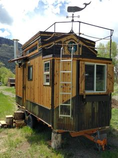 """Built on Brand New Custom 18′ """"Deck Over"""" Trailer (dual 3500lb axles). Approximately 200 sq. ft. Including loft. Just featured in Outside Magazine among others… http://www.outsideonline.com/2095186/custom-tiny-house Includes: – 2 downstairs doors and a hobbit door leading from loft to balcony. – 10 Double Pane Windows – 11 – 120 watt electrical outlets, including 4 built-in…"""