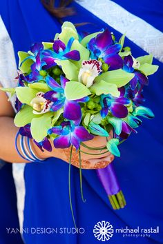 #green cymbodium #orchids, blue-purple dendrobium orchids, bear grass and royal #purple satin ribbon. More