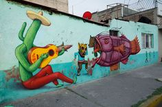 Aec of Interesni Kazki was recently in Mexico City and linked up with locals Saner and Sego to collaborate on the following wall.  Aec painted a hatted saguaro cactus playing a corn necked guitar, Saner is responsible for the two masked characters one who is dancing, and Sego with the purple fish.