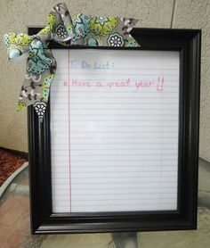 """But cheap picture frame, put lined paper and title top of it """"To Do List"""" then put clear glass cover over and use dry erase markers to keep your list current and save paper"""