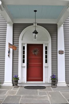 """No historic home in the South is truly finished until you paint the porch ceiling """"Haint Blue"""". This picture is my inspiration for the colors---just painted all our doors red---now its time for the ceiling! Grey Exterior, Modern Farmhouse Exterior, Exterior House Colors, Red Door House, House With Porch, Grey Composite Front Door, Grey House White Trim, Haint Blue Porch Ceiling, Front Door Porch"""