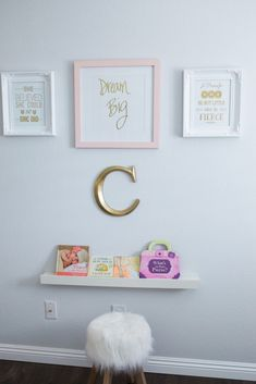 Adorable wall decor in this pink and gold baby girl nursery!