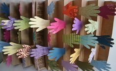 This Rainbow of Hands display is by Susan Kapuscinski Gaylord. Use as inspiration for display on Great First Lines. Have patrons guess the book tital for first line and then flip the hand for the answer.
