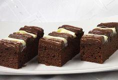 Negresa simpla cu topping de vanilie si cacao este un desert savuros ce nu-i va dezamagi pe gurmanzi. Prajitura este aromata datorita esentei de rom, iar topping-ul de vanilie si cacao ii confera in acelasi timp un aspect placut si un gust delicios. Ingrediente Negresa simpla cu topping de vanilie