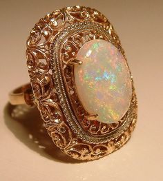 Vintage gold and opal filigree cocktail ring. I love opals.
