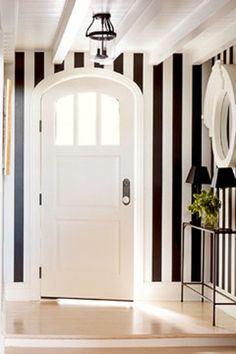So fun and all you need to use is painters' tape to create stripes on your wall.
