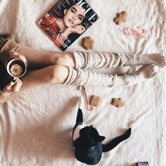 Comfy in bed on a Sunday morning with knee high socks, a cat + Vogue.