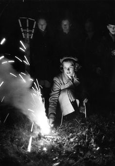 Charles Hewitt - Lighting A Firework. A girl lights a firework at a Guy Fawkes night party, 1952. ° Bonfire Night Guy Fawkes, Guy Fawkes Night, Photo Black, Black White Photos, Black And White Photography, Bonfire Night Food, Grunge Photography, Vintage Photography, Trip The Light Fantastic
