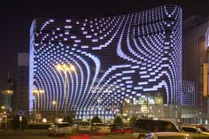 A growing trend is seeing lights and screens installed in facades to bring them to digital life in the evenings.