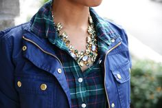 The colour of that blue jacket, the tartan printed shirt and that beautiful necklace.