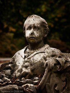 Creepy ass kid grave statue