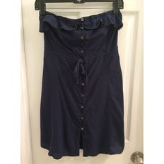 Juicy Couture Button-down Strapless Dress Fun and flirty dress by Juicy Couture. Has buttons, draw string tie, and eye hook top closure. Navy blue. Top is elastic and stretchy. Great condition. Juicy Couture Dresses Strapless