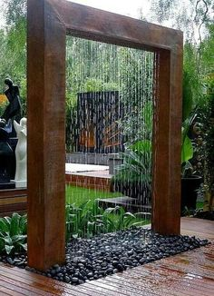 Looking for an out-of-the-ordinary water feature? If you don't have a slope for a waterfall and a fountain won't do, consider a 'rain shower' structure like this. This contemporary design would work well in a high-tech or zen garden.