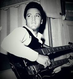 Elvis playing double. Double neck guitar