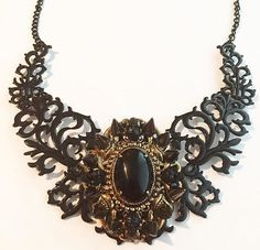 A personal favorite from my Etsy shop https://www.etsy.com/listing/483209789/skull-and-spike-bib-necklace