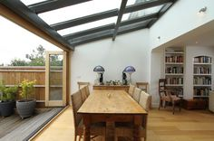 Glass extension, bifold doors and decking. Style At Home, Kitchen Diner Extension, Kitchen Extension Glass Wall, Kitchen Extension Roof Windows, Kitchen Extension Into Garden, Glass Extension, Extension Ideas, Rear Extension, Bifold Doors Extension