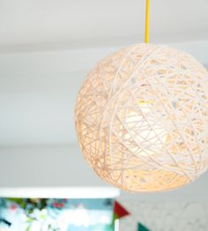 A similar designer lamp costs a fortune, but our homemade yarn light fixture costs about $20 to make!