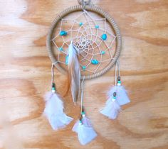 LOVE the turquoise and white beads!   Tan and Turquoise Feathered Dreamcatcher by LaurenLuvs on Etsy, $34.00