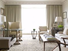 The crown moulding in this room is spectacular ... love the way the draperies flow behind it