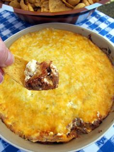 Taco Dip (many more yummy dips at this site!)    1/2 lb ground beef  1 can refried beans (I use fat-free)  1 packet taco seasoning  8 oz sour cream  2 cups shredded cheddar cheese    Preheat oven to 350.    In a skillet, brown the ground beef over medium heat, drain. Mix beans, cooked ground beef and taco seasoning. Spread bean mixture in the bottom of a 9x13-inch baking dish. Spread the sour cream on top of the beans and then top with cheese.     Bake at 350 for 25-30 minutes - until cheese is bubbly. Serve with Fritos.