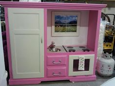 old entrainment center made into a cute play kitchen