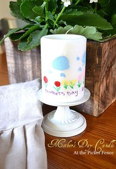 A great Mother's Day gift you can do with the kids.  Personalized painted candles tutorial from At The Picket Fence.