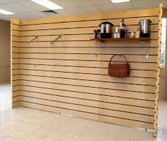 Dimensional Impact provider of genuine textured slat wall, designer decorative wall panels and fixtures to give depth to the retail experience. Wood Slat Wall, Wooden Slats, Pivot Doors, Sliding Doors, Wooden Wall Design, Decorative Wall Panels, Storage, Display Ideas, Google Search