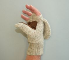 These novel fingerless Gloves / Mittens, with genuine deerskin at the palms and fingers and a soft fleece lining, have a layer of Thinsulate® added to them to ensure your fingers stay warm. 85% wool, 15% nylon. You can wear them as mittens by flipping over the Mitten Flap, or as Fingerless Gloves by folding the flap back over. Flap stays in place with small velcro hitch. Twenty dollars at Murray's Toggery Shop.