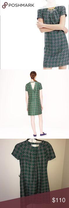 NWOT J. Crew shift dress Never worn. Pink green pattern on navy. High neckline, crossed over back. J. Crew Dresses