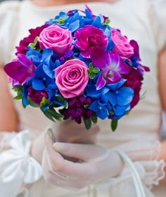 Beautiful bouquet using blue, green, pink, and purple color scheme