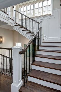 Your daily dose of Inspiration: Staircase wood treads. Staircase features wood treads and wrought iron spindles Brandon Architects, Inc. Staircase Remodel, Staircase Makeover, Staircase Railings, Iron Spindle Staircase, Bannister, Staircases, Railing Design, Staircase Design, Staircase Ideas