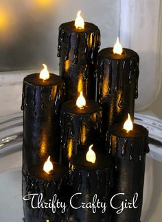 Thrifty Crafty Girl: 31 Days of Halloween - Faux Candles from cardboard tubes, hot glue, tea lights, and black paint. Halloween Series, Spooky Halloween, Theme Halloween, Halloween Candles, 31 Days Of Halloween, Holidays Halloween, Halloween Crafts, Happy Halloween, Halloween Decorations
