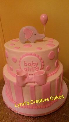 Pink baby shower cake with elephant