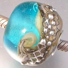 pandora charm beach glass | pn143 Aquamarine Beach. Round and cored with sterling. It measures ...