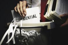 Man shredding confidential documents
