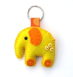 Cute idea - elephant felt keyring  I think I could do this ..... tail on the reverse side