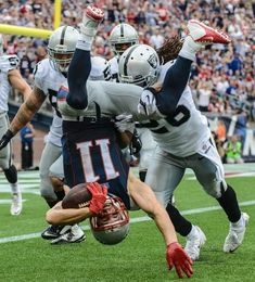 Best Photos from the Opening Month of the NFL Season - Wide receiver Julian Edelman of the New England Patriots is tackled by strong safety Usama Young of the Oakland Raiders. New England Patriots Football, Patriots Fans, Julian Edelman, American Sports, American Football, Sport Football, Football Helmets, Football Wall, Sports Teams