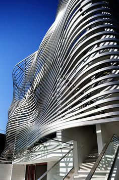 An Undulating Facade of Metallic Louvers Defines This Tokyo Residence and Store. By Amano Yoshihiro, head architect of Amano Design Office