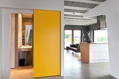 Yellow sliding doors conceal the bathroom