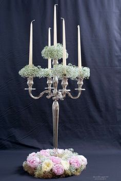 Hight centrepieces with gypsophila ,candles and peonies