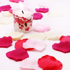 Decorate your wedding reception tables ahead of time. Strew these colorful silk rose petals down the aisle. Or simply toss to the bride (without worrying of stains).