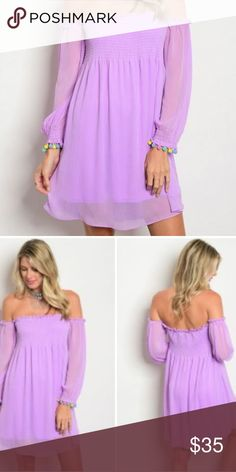 Lavender Tunic with Smocked Detail This is a lovely lavender piece with fun tasseled details on the sleeves! Dresses