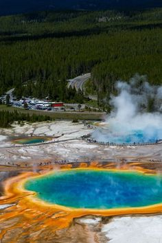 Grand Prismatic Spring, Wyoming: This rainbow-colored hot spring in Yellowstone National Park is deeper than a 10-story building and is the third largest spring in the world! Click through for more beautiful places to visit in the U.S.