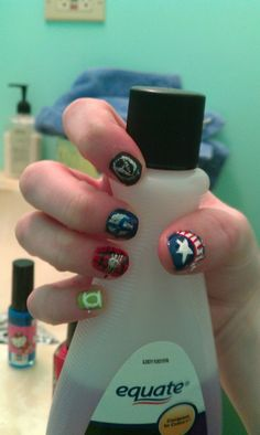 right hand of super hero nails for avengers weekend; green lantern, spidey, fantastic four, avengers logo, & captain America.