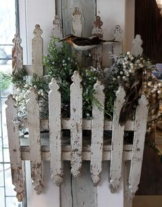 Cute decoration - two rows of pickets (looks like a short bed) filled with greenery - I love the chippy wooden picket frame, shabby chic decoration. I COULD USE THIS AS A WINDOW BOX..CUTE CUTE