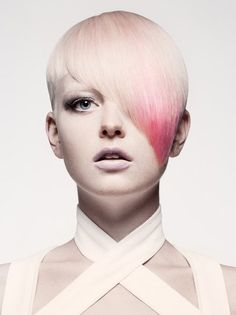 Short Asymetrical Punk Haircut For Women.  I wouldn't use these colors on me, but I like the idea of very subtle streaks leading into a splash of contrasting color at the low tip.
