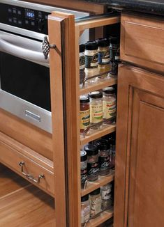Love The idea of a spice rack but don't want have the counter space? Great solution-Kitchen Cabinet Organization | Waypoint Living Spaces #RhodeIslandKitchens