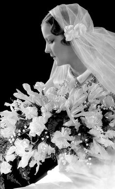 1930s bride- love the simple Juliet cap style veil pinned with flowers at ear.